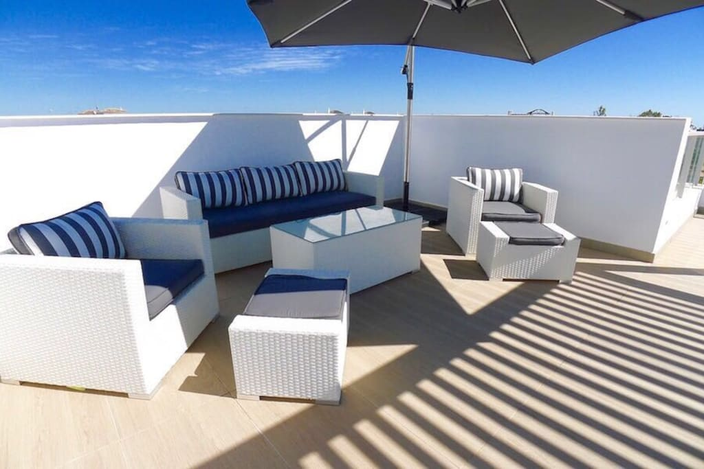 part of the roof terrace, with views of the sea and the mountains