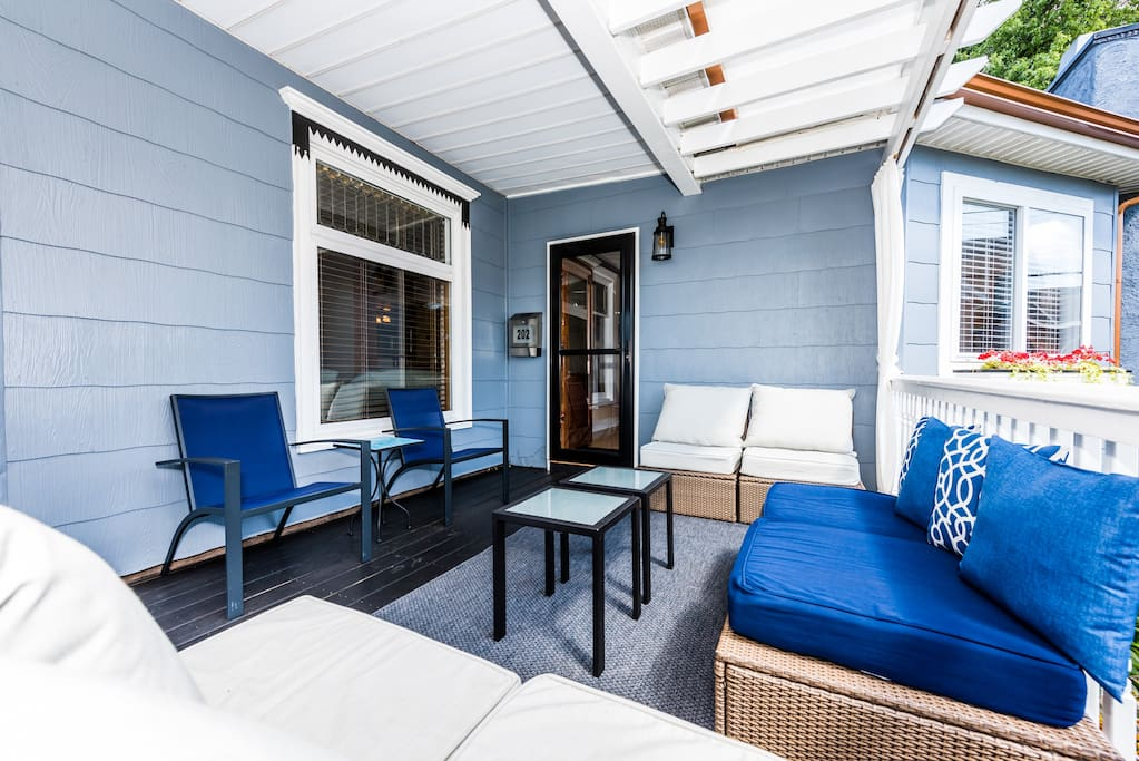 The lounge area on the covered warp-around porch is available for outdoor relaxing and lounging.