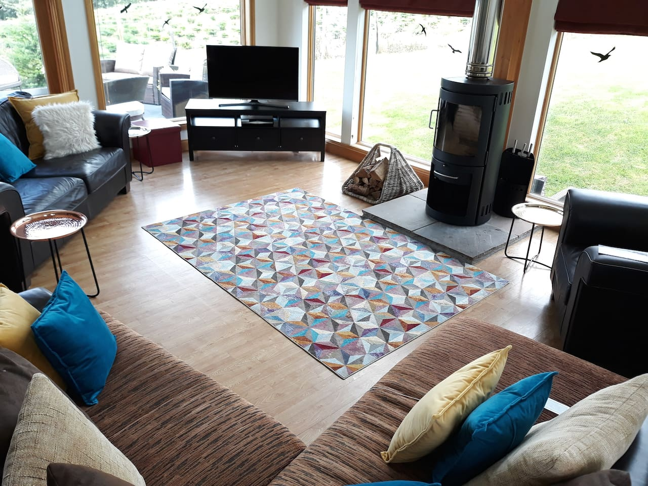 Spacious open plan living with fabulous woodburner and all round open views.