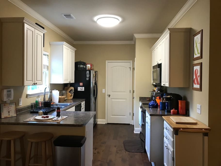 Our kitchen: ample space for food prep with a dual basin sink. We have a Keurig that you are free to use (we have refillable filters to cut down on environmentally unfriendly plastic K-Cup pods). We also have a variety of different teas as well!