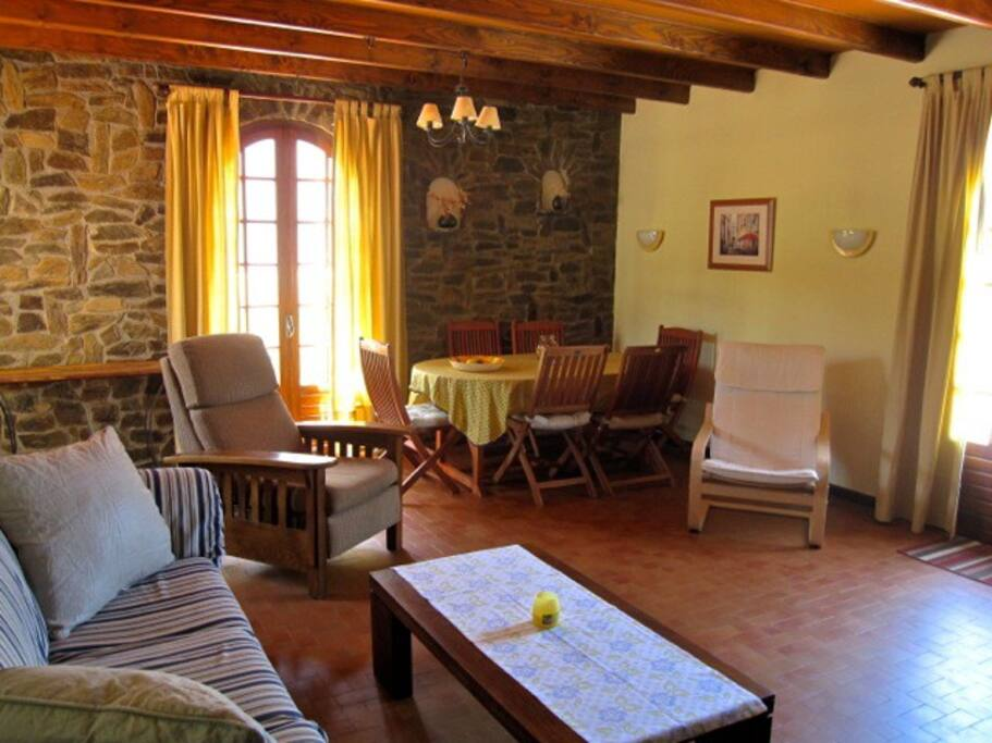 Living room with convertible queen sofa bed, three doors to the outside and outstanding views of the Canigou