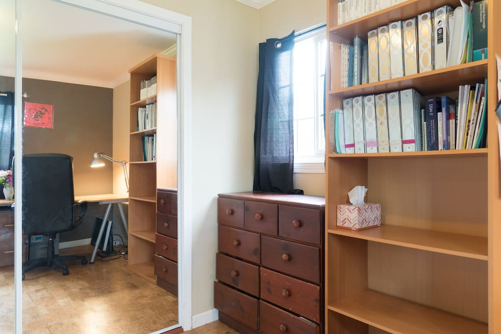 Your room- mirrored closet doors on the left, dresser and book shelf to the right.