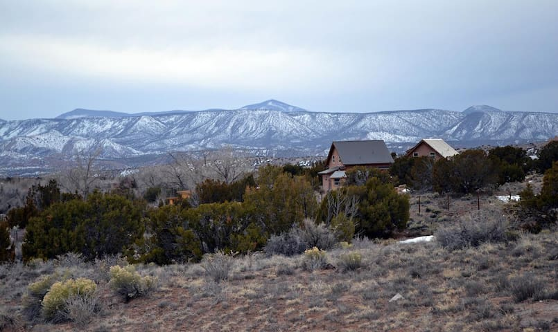 "Looking down from northern slope onto Hawk House & Raven House. Both homes are available to rent separately or together. To rent both, search ""Unashay Home Retreat"" (Abiquiu) via Airbnb. Perfect for artist/ writing retreats, family gatherings, etc."