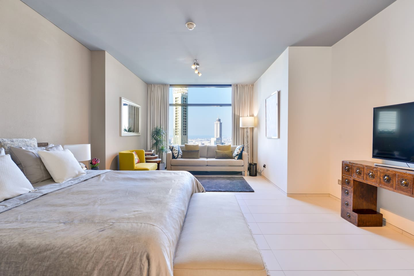 Extremely large master bedroom with beautiful city skyline views.