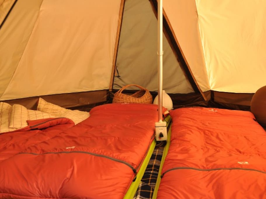 The tent is equipped with Snowpeak's Futon style sleeping bags and amenities