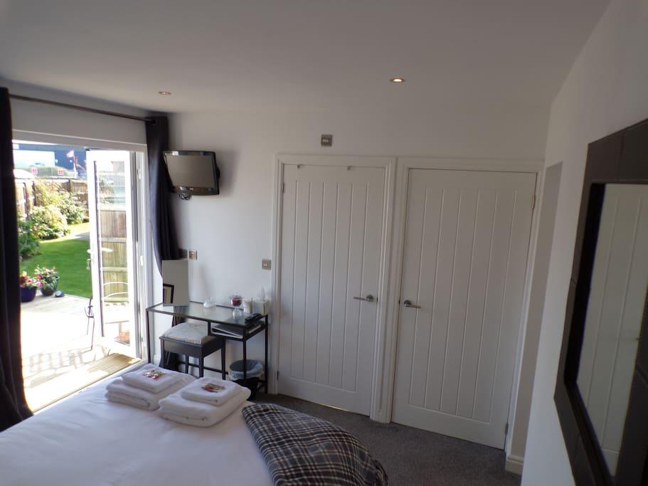 Bedroom with bathroom and wardrobe doors