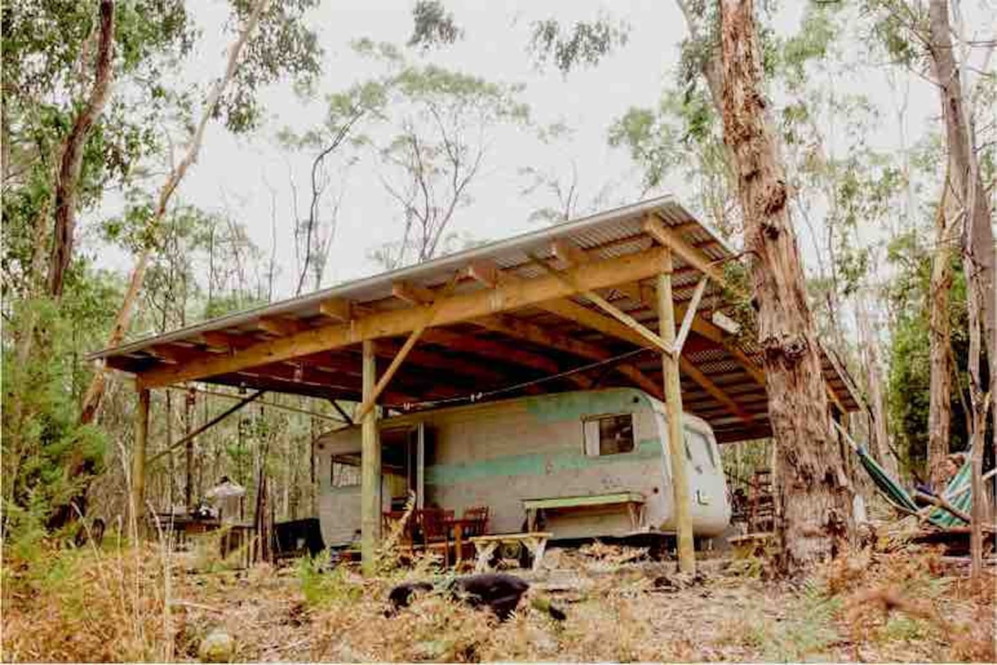Our Bush Van under the cover of our large farm Shed. Perfect for shady afternoons in the hammock or spacious outdoor time while the rain comes down on the corrugated iron roof...