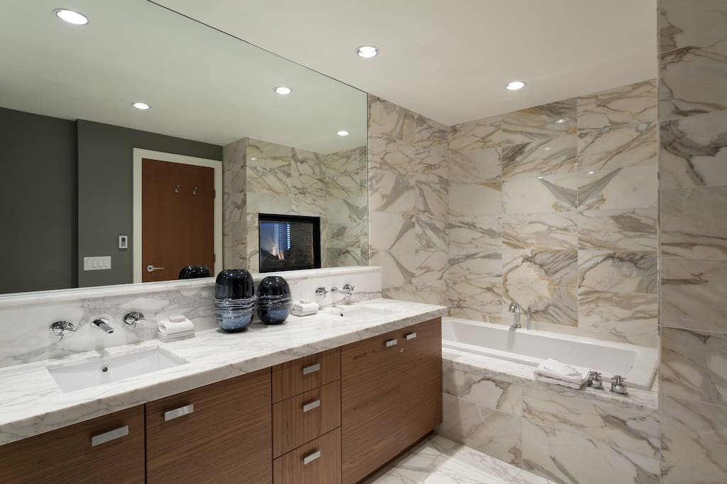 Master ensuite with deep soaking tub and separate glass enclosed shower.