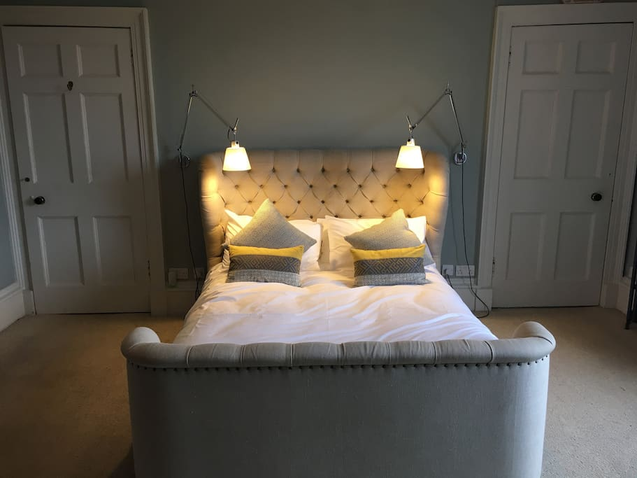 Stunning main bedroom with large Georgian wardrobe, en suite with walk in rain shower and views of edinburgh castle