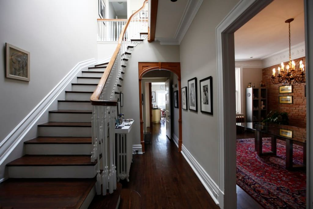 staircase to second floor, hallway to kitchen and dining room