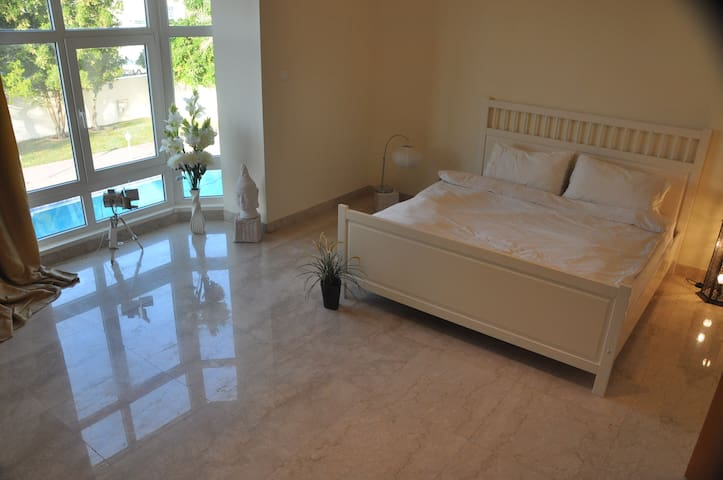 Master Bedroom with En Suite Bathroom at Villa Ohm - Dubai - Villa