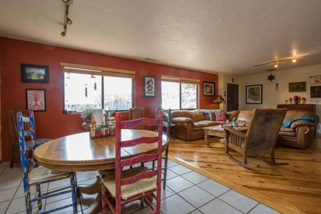 Informal dining area w/living room beyond.