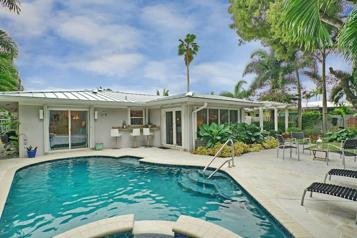 Master Suite has direct access to the heated tropical pool and hot tub. Sun Room and Third Guest room also have French doors to the outside. Plenty of seating for dining or lounging in your private back yard