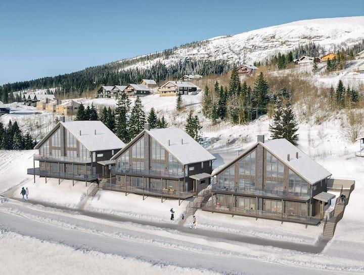 Nyproducerad lägenhet i Åre Tegefjäll med ski-in