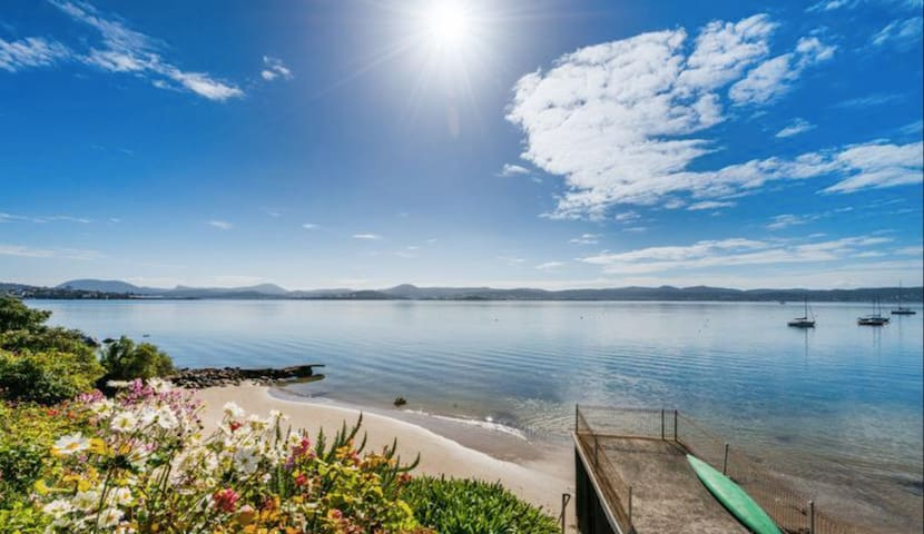 Absolute Waterfront Apartment in Sunny Sandy Bay