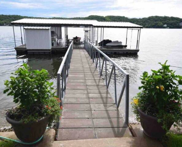 Lake front home on level lot with LARGE DOCK!