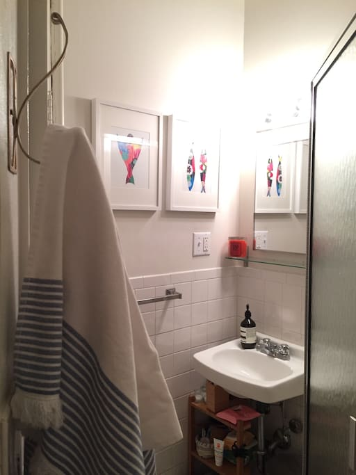 Efficient bathroom with prints by a lovely Portuguese artist