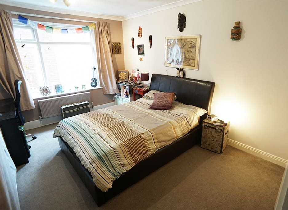 Big, warm bedroom, with Extremely comfy double bed & mattress. Full-sized desk for working if needed. We also have a very comfy single futon bed that can easily fit in the space to the right, if separate beds are preferred.