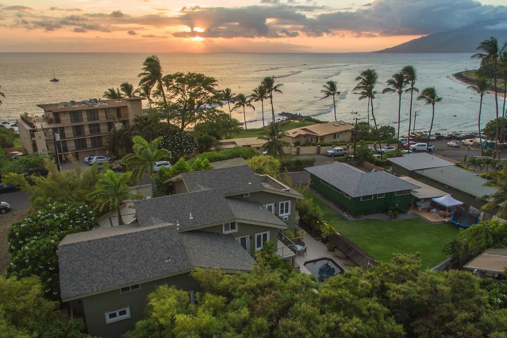 Aerial view of the sun setting across the street from Wailea Inn