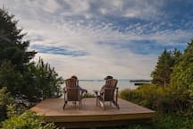 There is a deck down by the water for guests to enjoy.