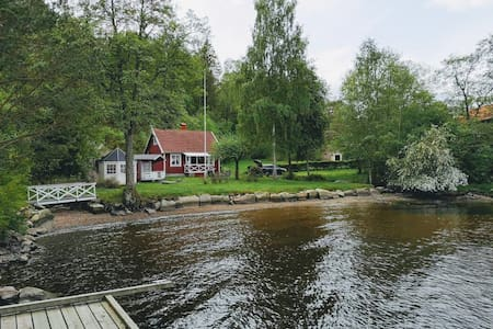 Cozy swedish cottage at idyllic beach and boat