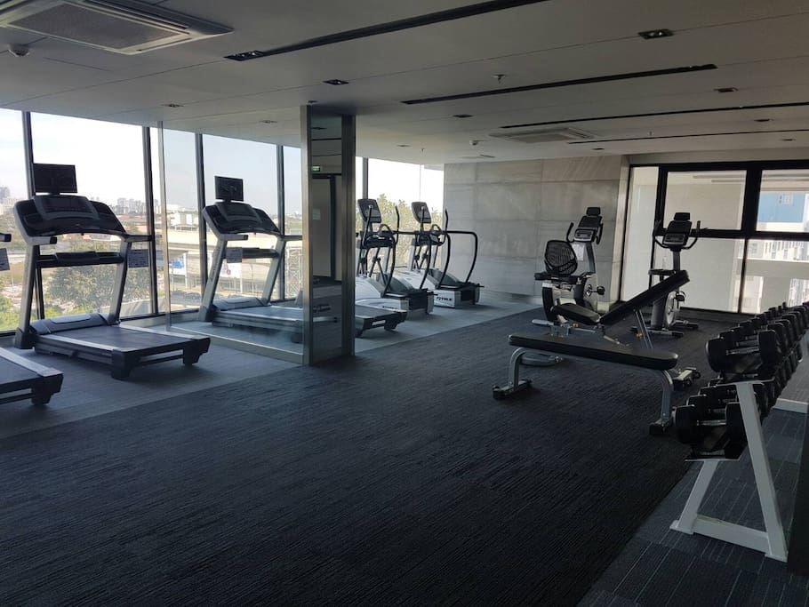 Modern full option Gym with the city scenery.