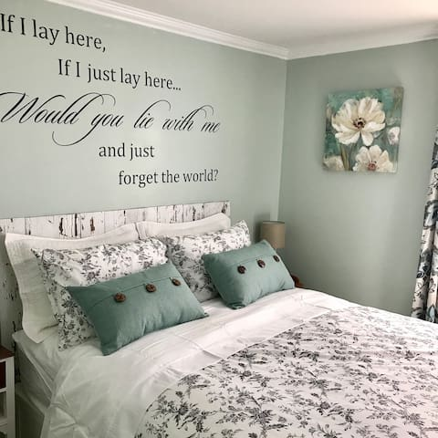 The bedroom is painted a soothing sage color.