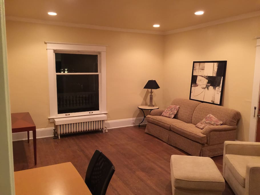 Spacious living area with queen pull out bed and desk for working.