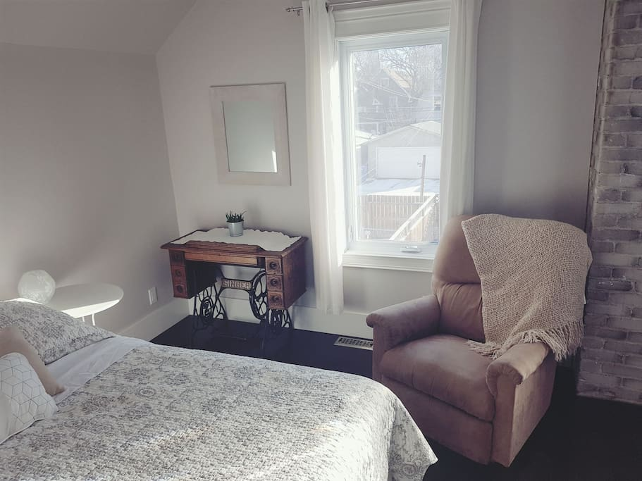 Bedroom 1: queen bed, balcony, walk-in closet, La-z-boy recliner, full length mirror.