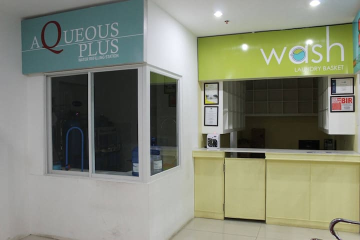 Water refilling station and laundry shop inside the condo premises!
