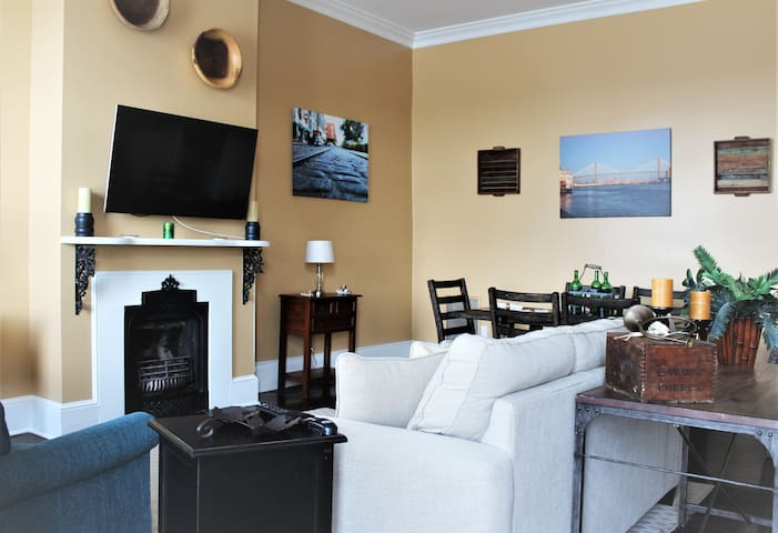 Cozy seating, large flat screen TV, perfect for a night in.