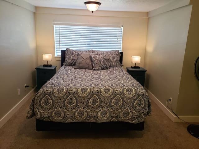 2nd bedroom with a Queen bed and a dresser. This room also has touch on and off lamps with cell phone chargers and two nightstands.