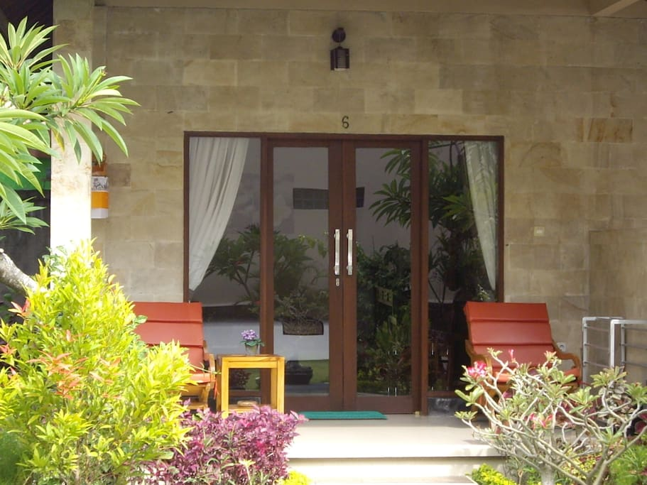 Garden View Room with Table and Chairs on the verandah for your relaxation