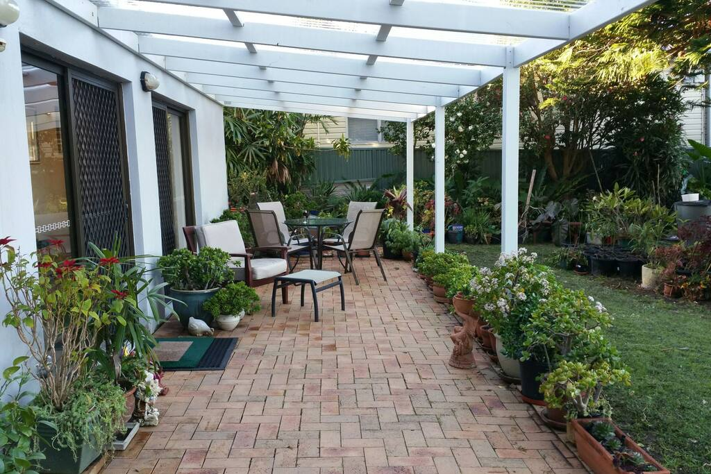 Comfortable outdoor under cover area. Enjoy outdoor dining or relax on one of the lounges.