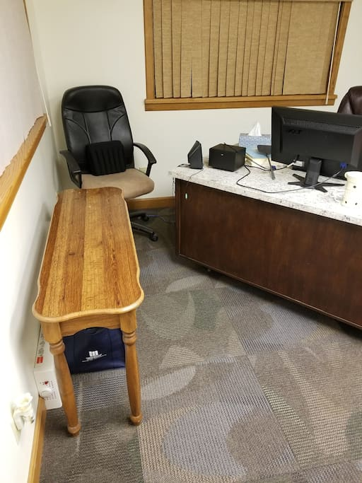 Office space including large desktop space for laptop and  executive chair, large computer screen available to attach to your laptop.  Wall heater for private control.