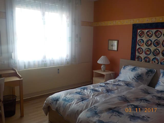 View of room with window and desk.