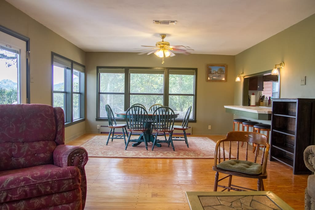 Open living and dining room floor plan with bartop to kitchen.