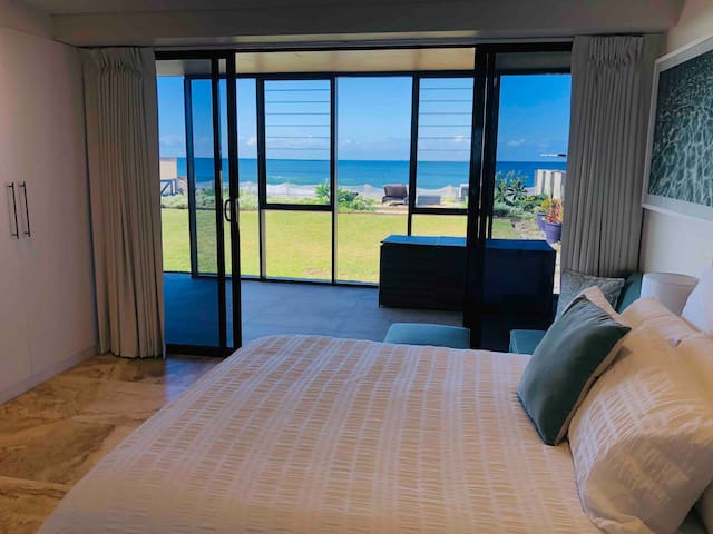 The Seagreen Suite - Besides the magnificent view, this room also provides private entry and exit via glass sliding double doors. A built-in wardrobe is also shown, with coathangers and a full length mirror.  Block-out curtains are for a sleep-in!