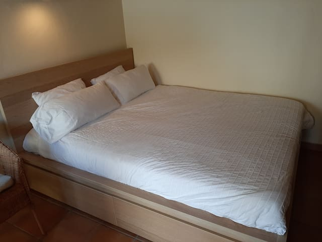 Double bed with linnen and towels