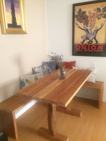 Cozy dining nook with reclaimed wood table and benches - seats 4 comfortably