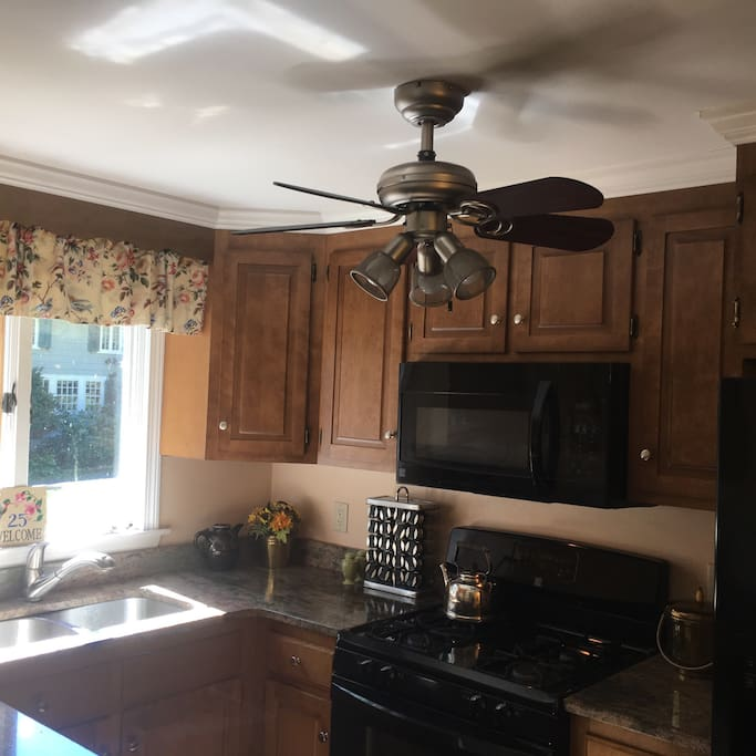 The kitchen has been newly renovated with granite counter tops, new flooring,  gas stove and microwave.
