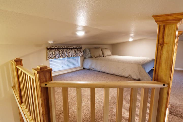 Loft with queen size bed. Please note the loft has a five foot ceiling. This is only a sleeping area.
