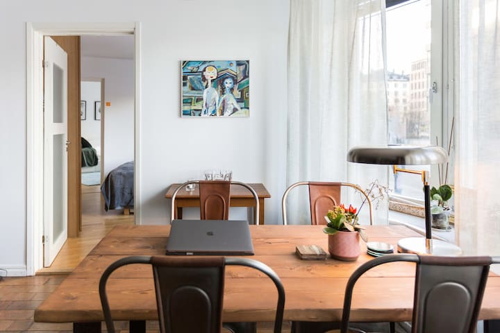 Dining table and also a good workspace. Made of swedish pine wood. Here you can see the entrance to the two bedrooms I have listed here: ROOM ONE and ROOM TWO and how they are connected.  This photo is taken by an official Airbnb professional photographer.