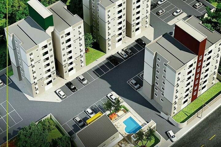 Apartamento com sacada e churrasqueira