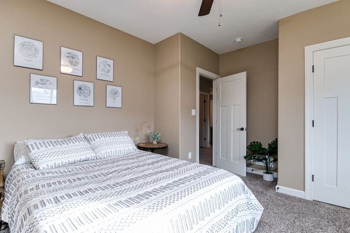 Queen bedroom with closet. Blackout blinds lends to great sleep, or open them up for a good dose of afternoon sunlight.