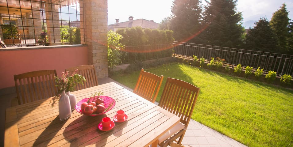 Spacious flat private garden sharing pool