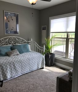 Aqua guest bed room/sun room suite, is part of the Nashville Suite and has it's own private bathroom. Located on the main level behind the kitchen. Day bed, with pull out trundle underneath. Dresser w/bench and closet.