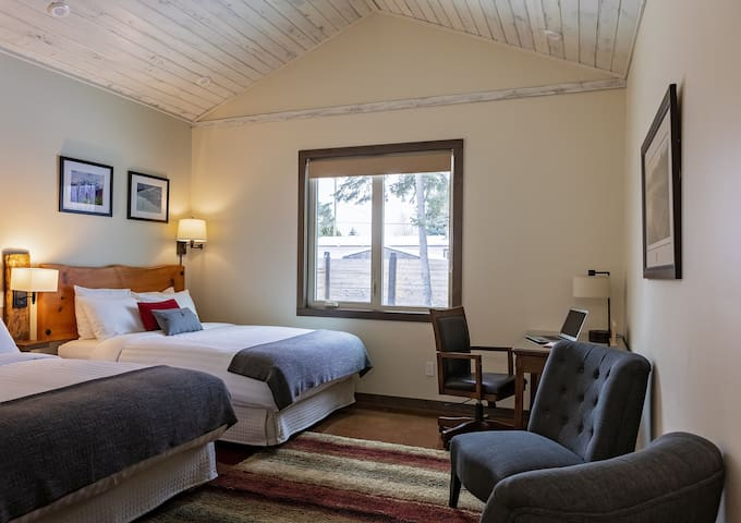 The MONASHEE room...2 queen beds, pillow topped...work space and walk in closet. Master bathroom with soaker tub and shower.