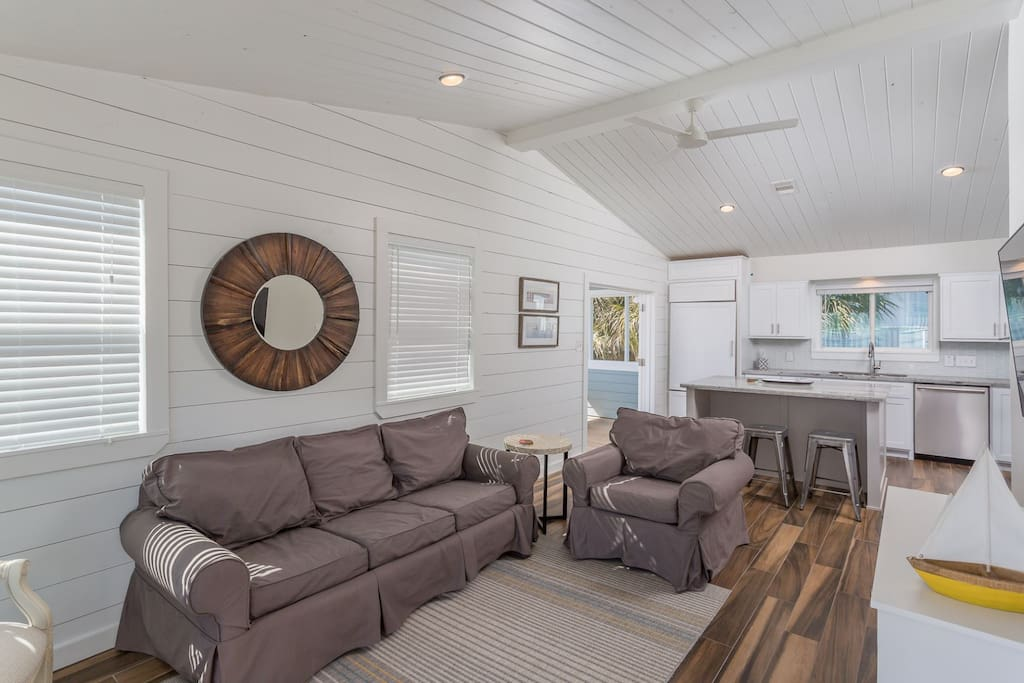Open Floor Plan, Vaulted Ceiling, Lots of Windows & White Shiplap Walls Make this a Perfect Beach House