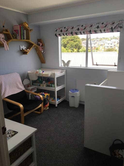 Babys room with cot and change table